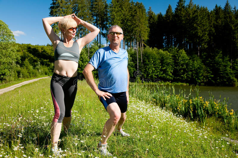 Download Senior Couple Doing Sport Exercising Outdoors Stock Image - Image of outdoors, people: 14255331