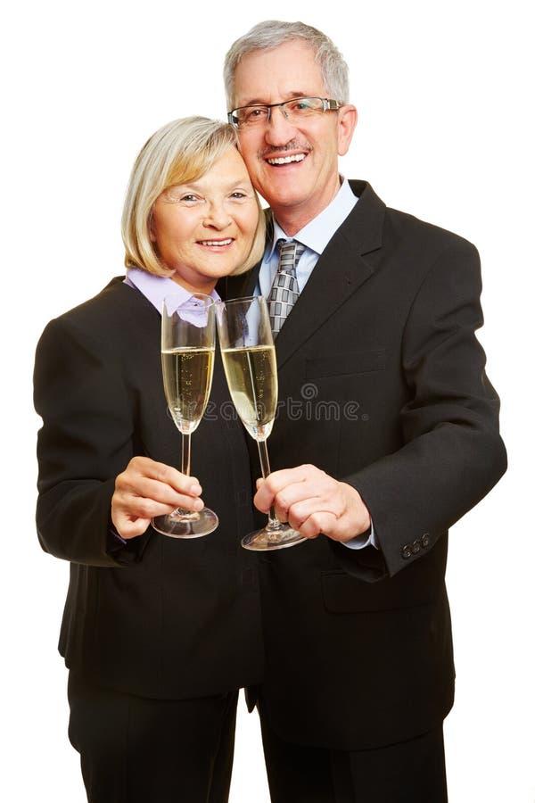Senior couple drinking champagne stock photography