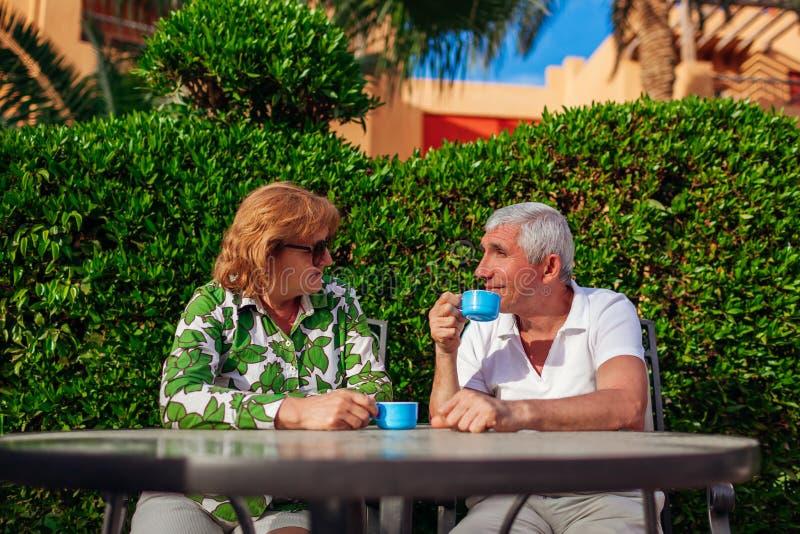 Senior couple drinking tea in hotel cafe. People enjoying vacation. Valentine`s day stock photo