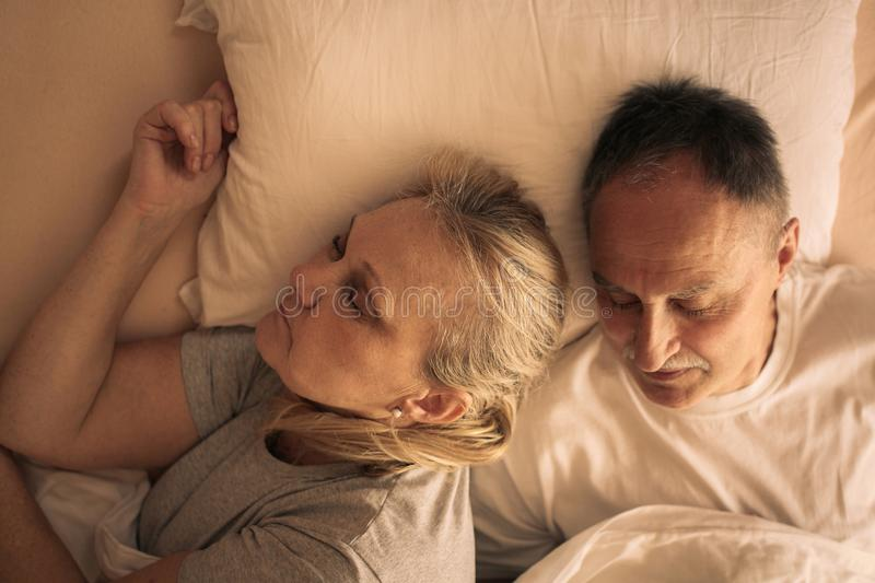 Senior couple embracing and sleeping. royalty free stock photos