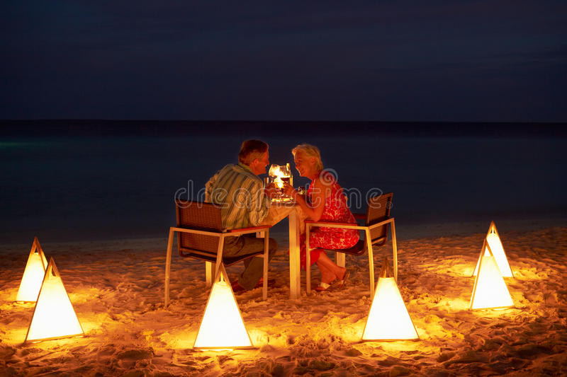 Download Senior Couple Enjoying Late Meal In Outdoor Restaurant Stock Photo - Image: 32065628