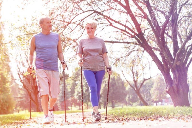 Senior couple enjoying morning walk in park royalty free stock photography