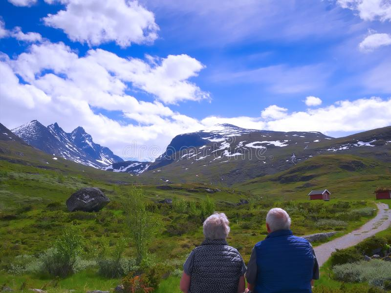 Senior couple enjoying a mountain view in beautiful Norway royalty free stock photography