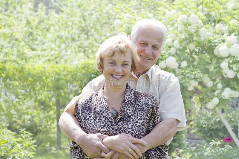 Senior couple enjoying in park. Portrait of a romantic senior couple stock image
