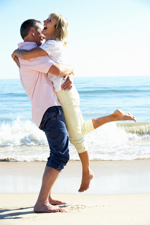 Senior Couple Enjoying Romantic Beach Holiday royalty free stock photos