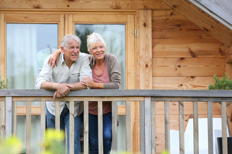 Senior couple enjoying their relaxing holidays royalty free stock photo