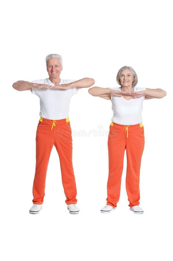 Free Senior Couple Exercising Isolated On White Background Royalty Free Stock Images - 152411029
