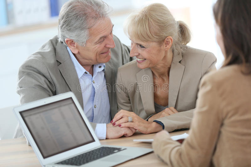 Senior couple with financial advisor stock photos