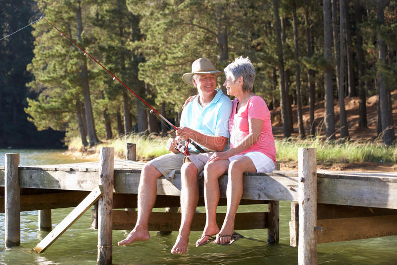 Download Senior Couple Fishing Together Stock Image - Image of line, peaceful: 21097445