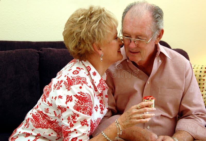 Senior Couple Gift Giving Stock Photos
