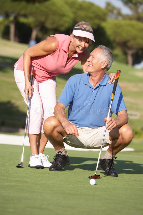Senior Couple Golfing On Golf Course royalty free stock images