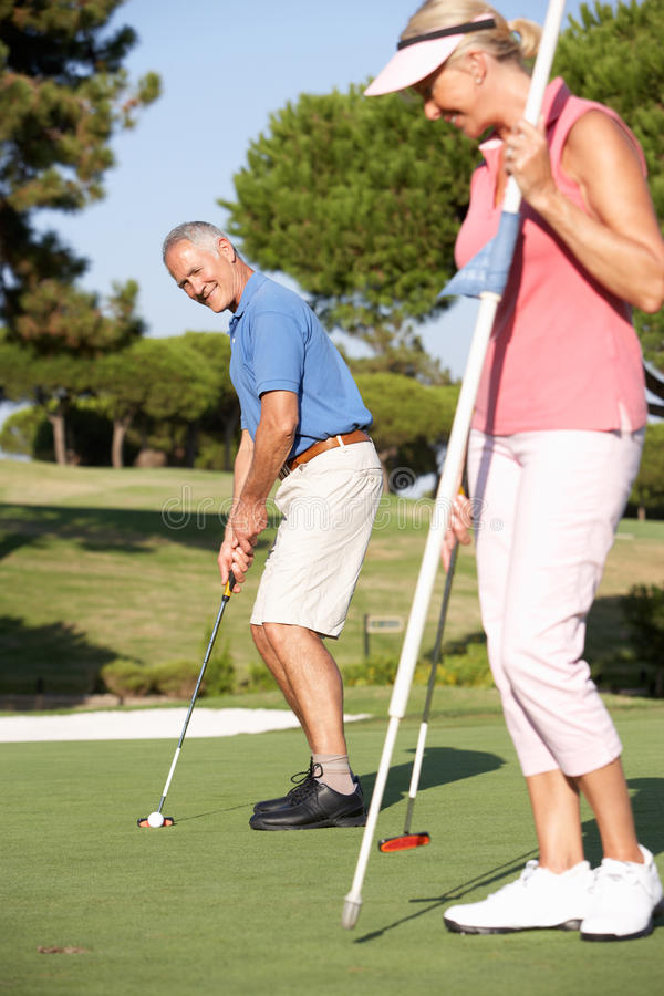 Free Senior Couple Golfing On Golf Course Royalty Free Stock Image - 16304256
