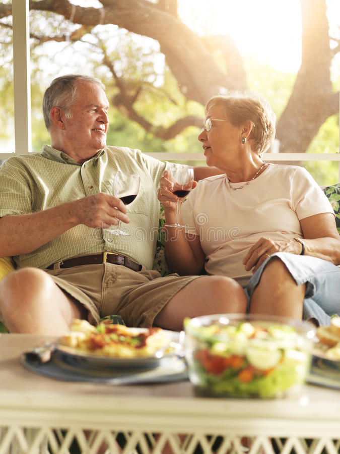 Senior couple having dinner on patio royalty free stock photo