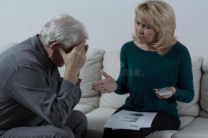 Senior couple having financial troubles stock images