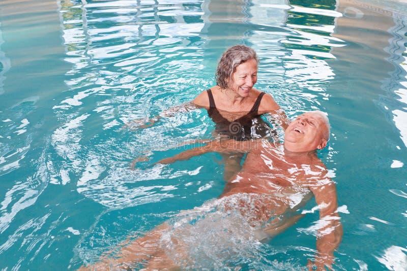 Senior couple is having fun with aqua fitness stock photos