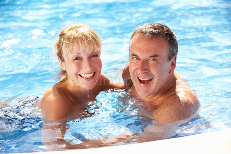 Senior Couple Having Fun In Swimming Pool stock image
