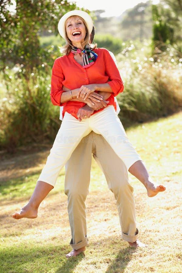 Download Senior Couple Having Fun Together In Garden Stock Image - Image: 26615535