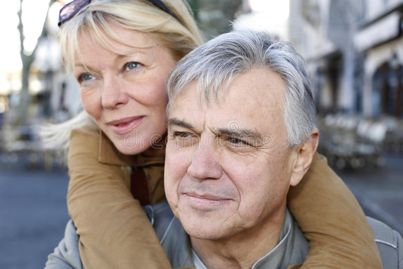 Senior couple having fun in town royalty free stock images