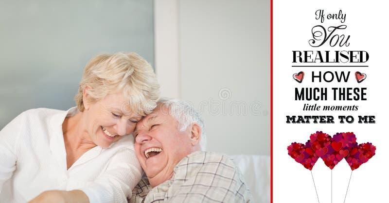 Senior couple having fun and valentine text stock image