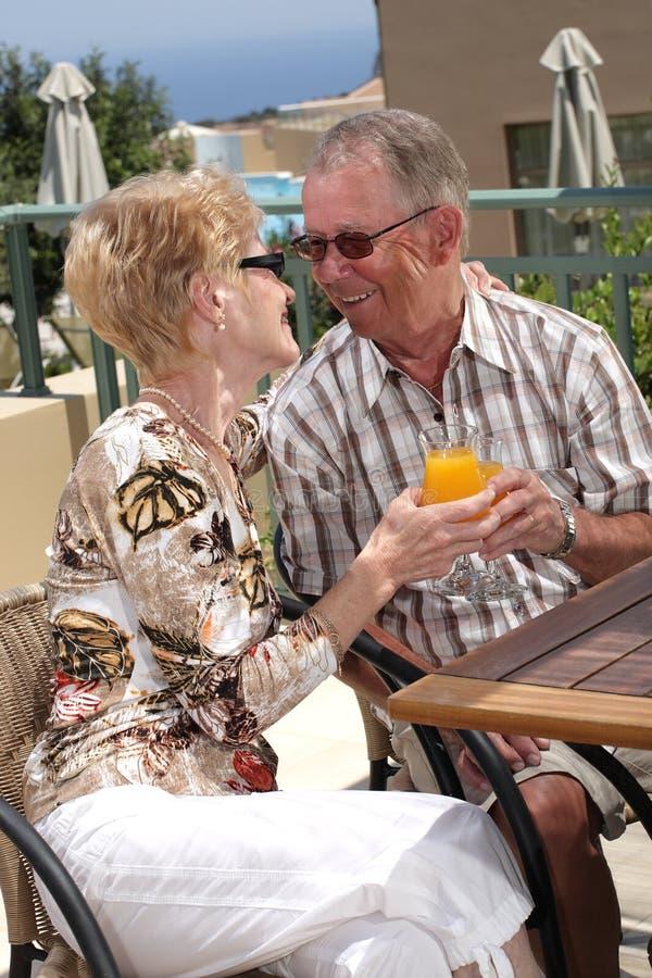 Senior couple having lunch on a balcony. Romantic senior couple having lunch on a balcony stock image