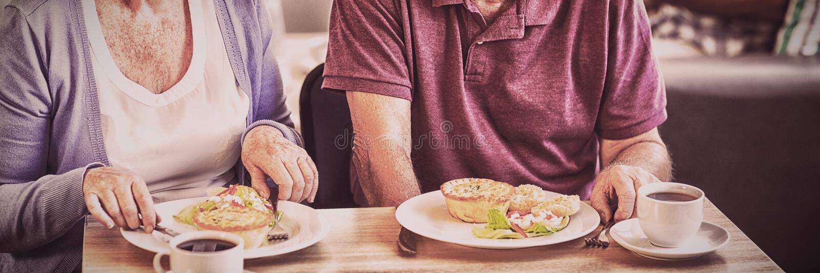 Senior couple having lunch together stock image