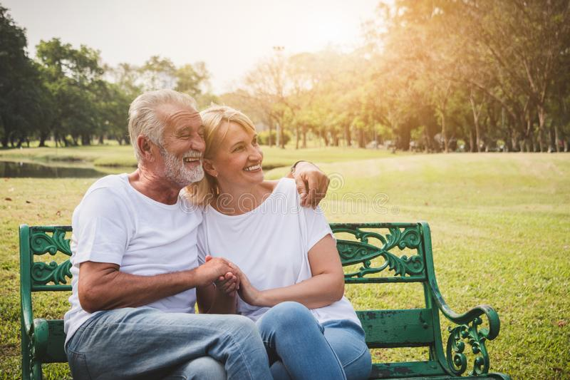 Senior couple having romantic and relax time in a park stock photos