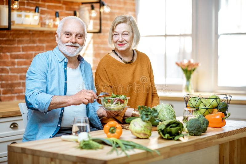 Senior couple with healthy food at home stock photo