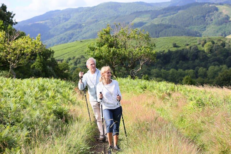 Senior couple hiking royalty free stock photo