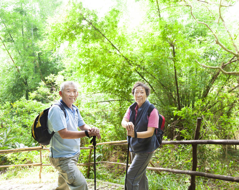 Senior couple hiking in the nature royalty free stock photo