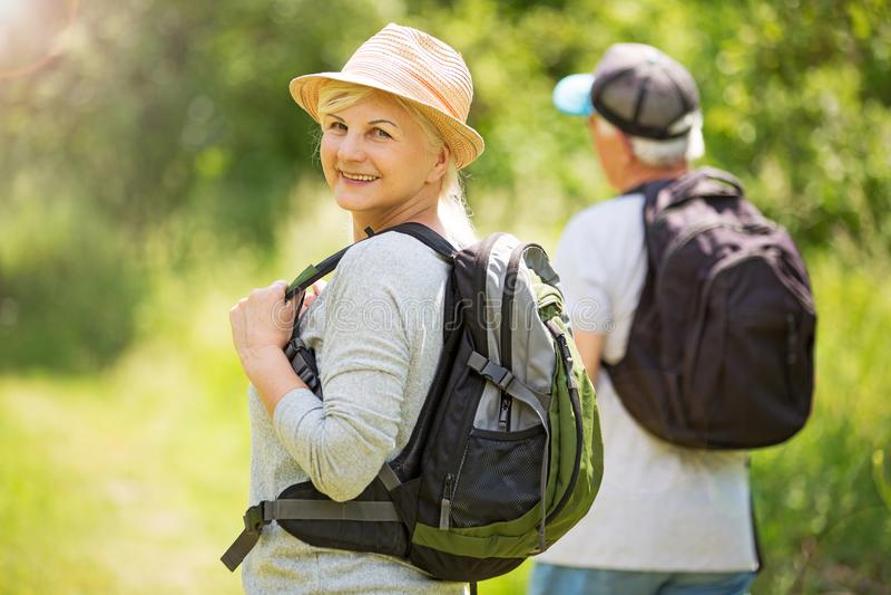 Senior couple hiking. Smiling happy elderly seniors couple stock photo