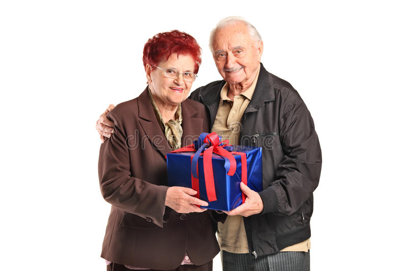 Download A Senior Couple Holding A Gift Stock Photo - Image of package, adult: 20338016