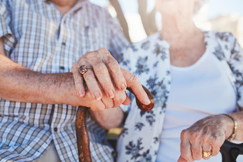 Senior couple holding hands royalty free stock images