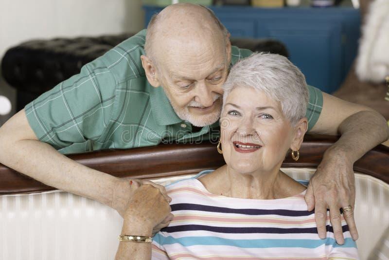 SeniorCouple Holding Embracing with smiles stock photography