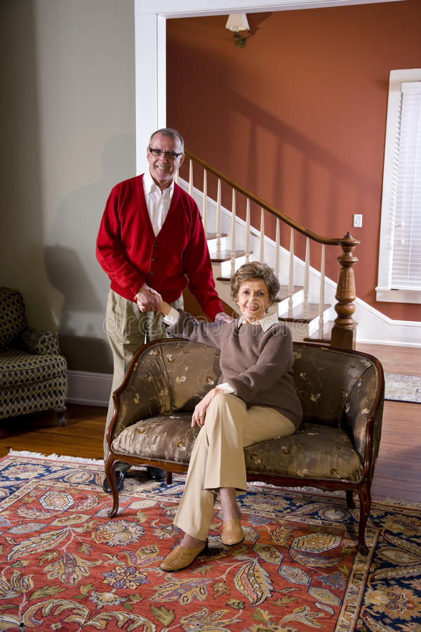 Senior couple at home in living room. Portrait of senior couple at home in living room stock photography