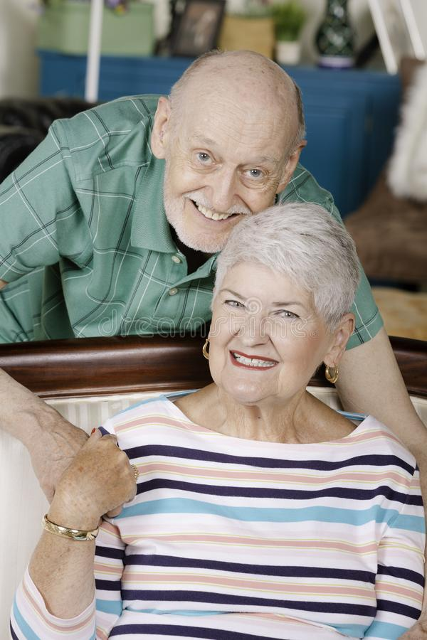 Senior Couple Holding Hands on the couch royalty free stock images