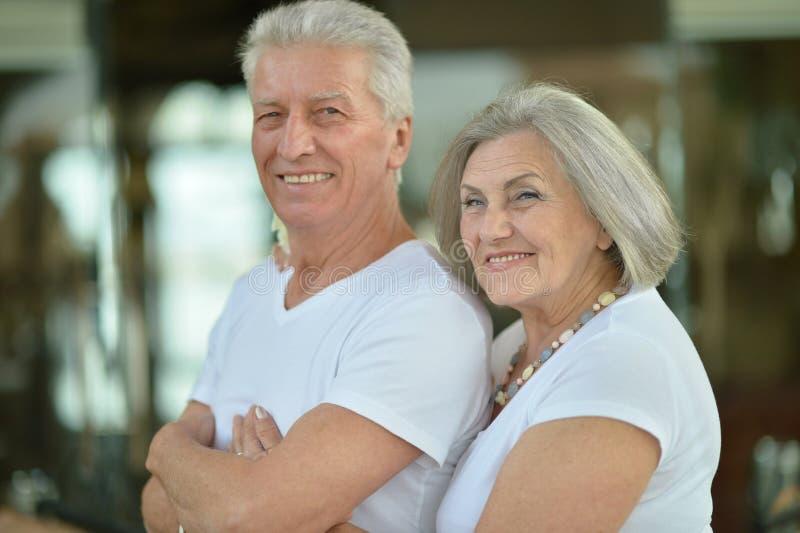 Senior couple at hotel resort hugging. Happy Senior couple at hotel resort hugging stock image