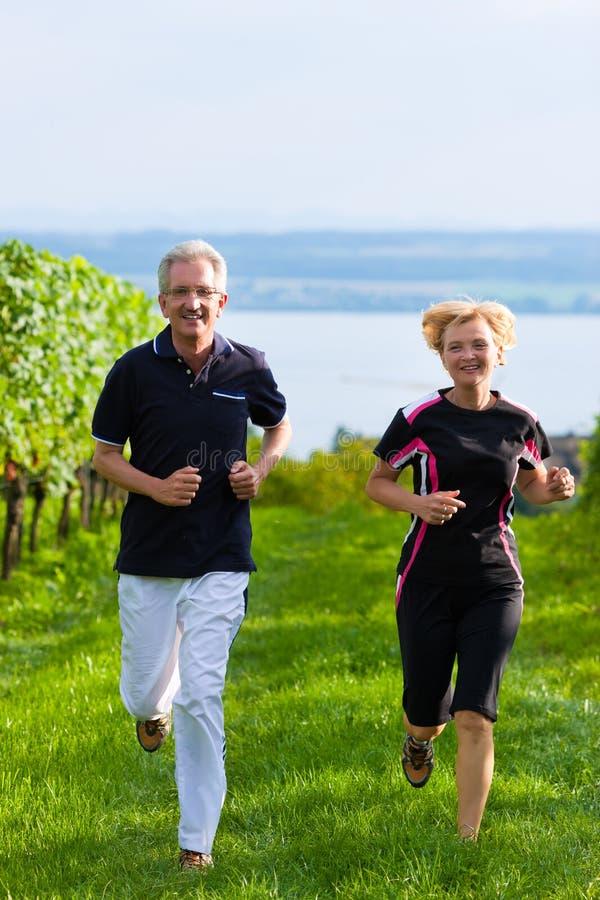 Senior Couple Jogging For Sport Stock Image