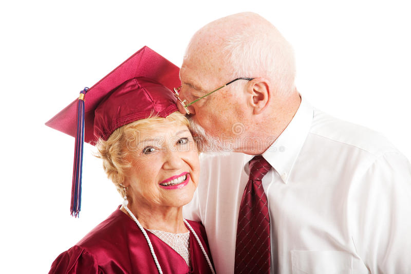 Download Senior Couple - Kiss For The Graduate Stock Image - Image: 24903851