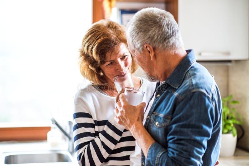Senior couple in the kitchen. royalty free stock photos