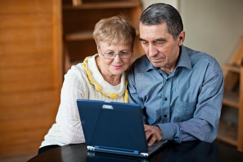 Senior couple on laptop stock images