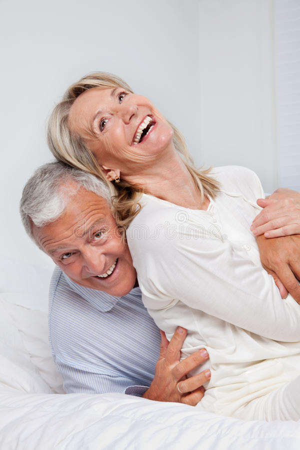 Senior Couple Laughing Together stock photo