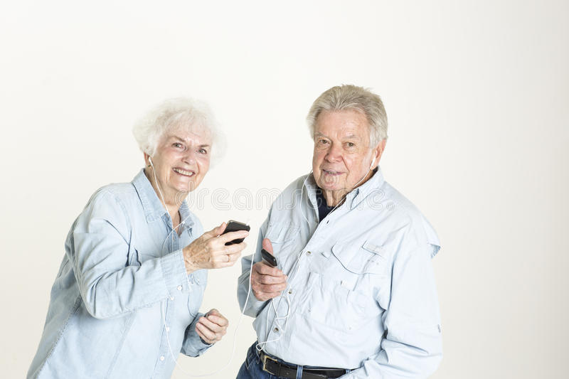 Download Senior Couple Listens To Music Stock Photo - Image: 33488444