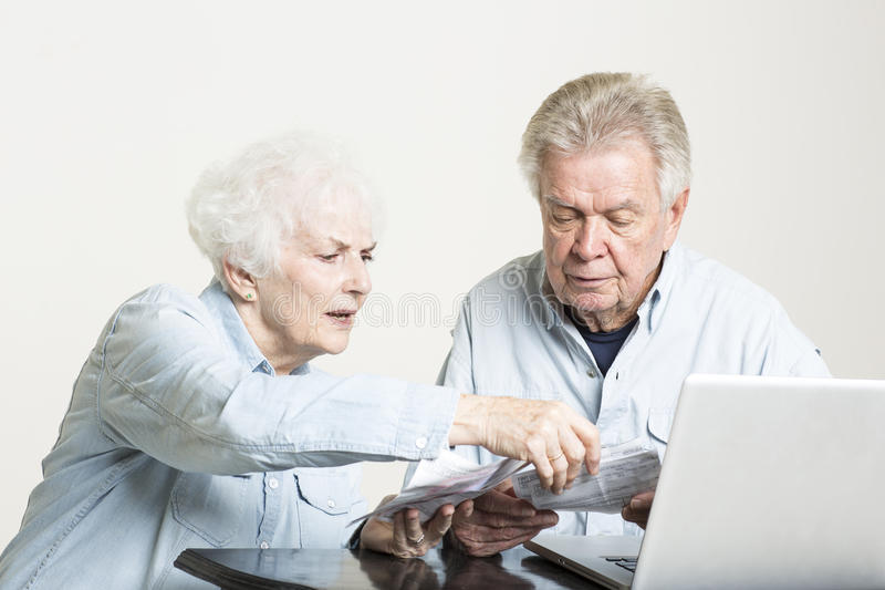 Download Senior Couple Is Looking At Bills Concerned Stock Photo - Image: 33488384