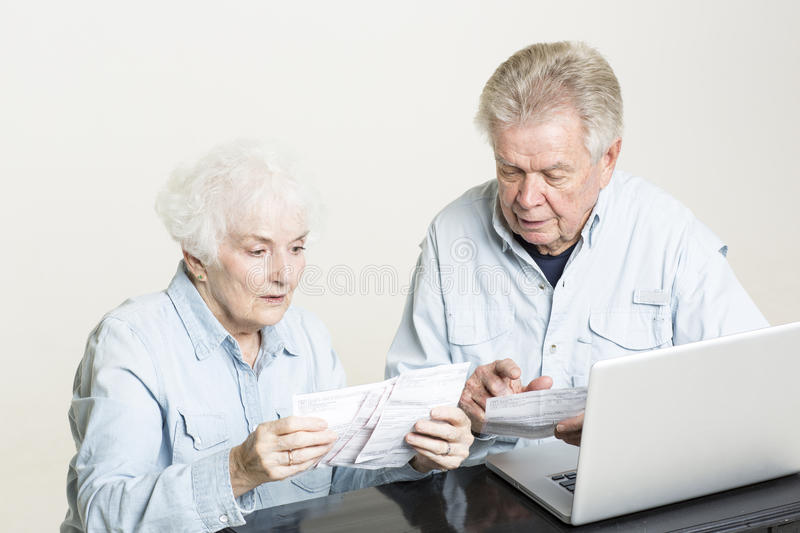 Download Senior Couple Is Looking At Bills Concerned Stock Photo - Image: 33488398