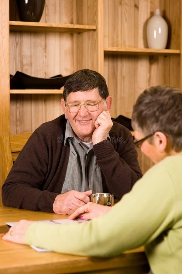 Senior couple looking at brochure royalty free stock photos