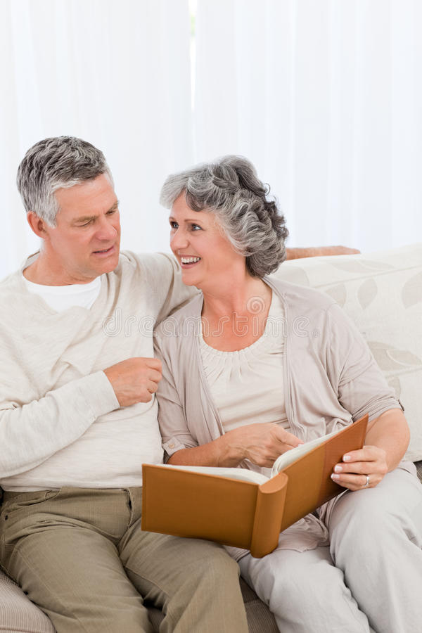 Download Senior Couple Looking At Their Photo Album Stock Image - Image: 18108603