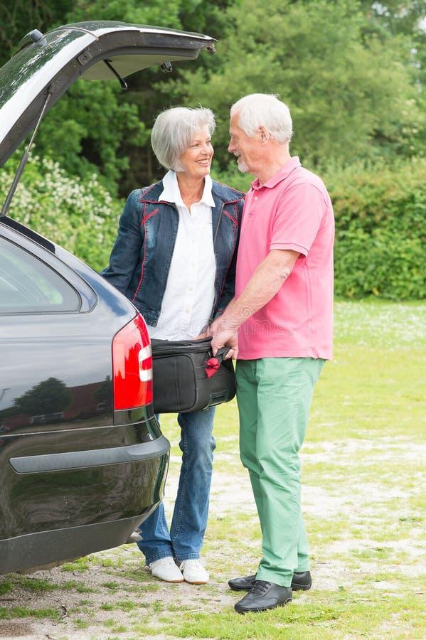 Download Senior couple with luggage stock photo. Image of beautiful - 32020850