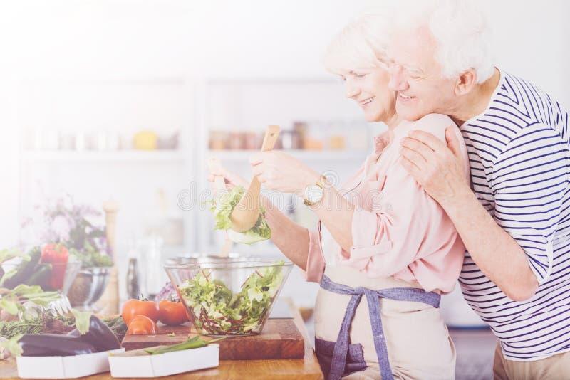 Senior couple making salad stock photos