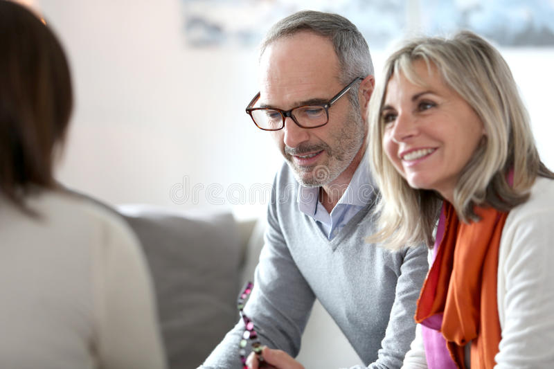 Senior couple meeting banker royalty free stock images
