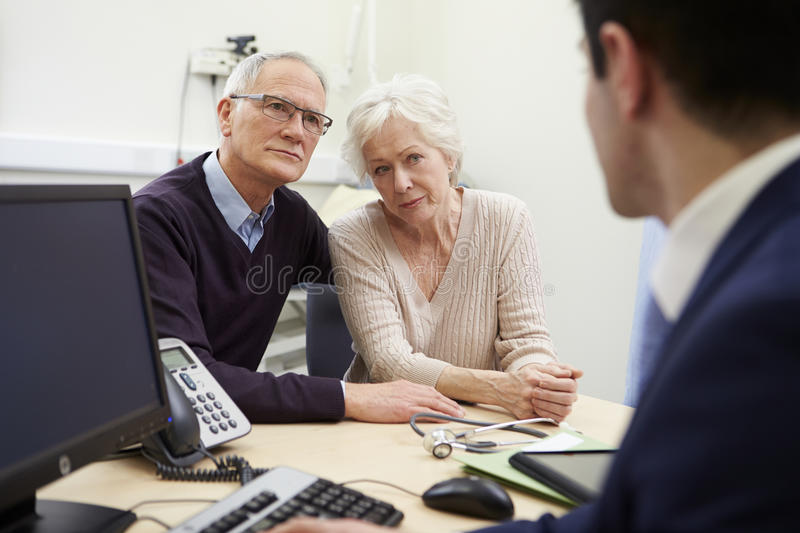 Senior Couple Meeting With Consultant In Hospital royalty free stock image